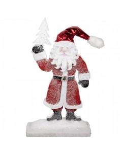 Papá noel con abeto en la mano con restos de nieve para la decoración navideña de centros comerciales calles tiendas